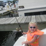 Teaching Kids How to Fish while Boating